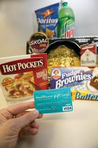 Smokes and snacks purchased with a healthcare gift card prove Highmark's latest product isnt all about health. [Card number has been changed] - HEATHER MULL