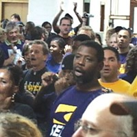 Some 100 union members demonstrated outside the door to Mayor Luke Ravenstahl's office for an hour, demanding to discuss city development policy.