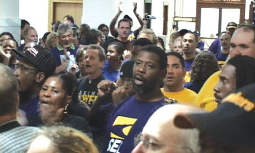 Some 100 union members demonstrated outside the door to Mayor Luke Ravenstahl's office for an hour, demanding to discuss city development policy. - CHRIS POTTER