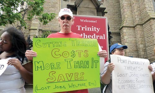 Stan Covert protests a PAT service-reduction plan prior to the authority's meeting on Sept. 24. - LAUREN DALEY