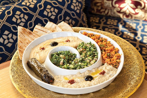 Starter selection including: hummus, baba ghanoush, stuffed grape leaves, tabuleh and red tabuleh