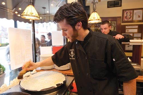 Steffon McCulry makes a crepe in Paris 66's open kitchen. - PHOTO BY BRIAN KALDORF