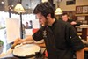 Steffon McCulry makes a crepe in Paris 66's open kitchen.