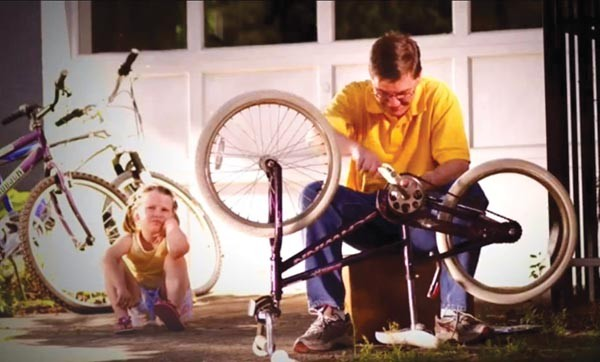 """Sure, I know how to fix things, honey. But only in ways that are revenue-neutral. That's why I'm taking parts from your bike to fix your sister's."""
