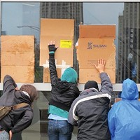 Taking the Mitts off: Some 30 demonstrators took part in an Oct. 27 Occupy Pittsburgh-affiliated protest at Consol Energy Center, where Republican presidential candidate Mitt Romney was holding a fundraiser. Romney's largest source of contributions, they pointed out, is Wall Street and the financial sector.