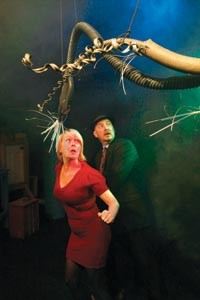 Tami Dixon and Jeffrey Carpenter, of Bricolage Production Co., flee a Martian invader. - HEATHER MULL