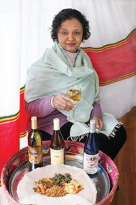 Tana Ethiopian restaurant manager Martha Vassar showcases several brands of imported honey wine. - HEATHER MULL