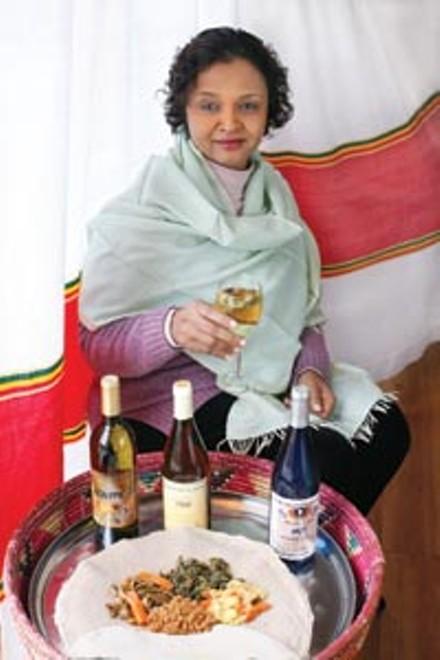 Tana Ethiopian restaurant manager Martha Vassar showcases several brands of imported honey wine. - HEATHER MULL