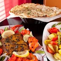 All India tandoori shrimp, chicken, salmon, aloo Gobi and garlic nan. Photo by Heather Mull