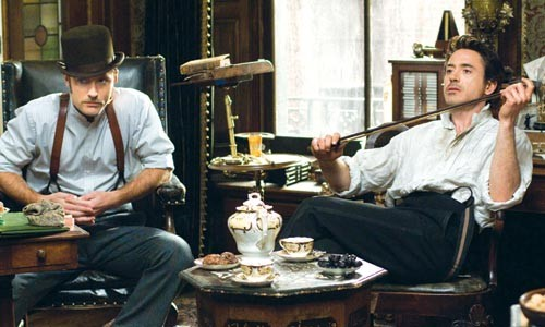 Tea for two: Watson (Jude Law) and Holmes (Robert Downey Jr.) share a moment.