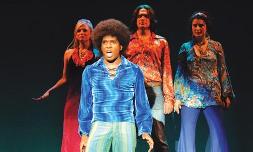 Teddey Brown (foreground), with (left to right) Tess Soltau, Bradley Beahen and Tess Primack, in Pittsburgh CLO's production of 8-TRACK: The Sounds of the 70's. - PHOTO COURTESY OF MATT POLK.