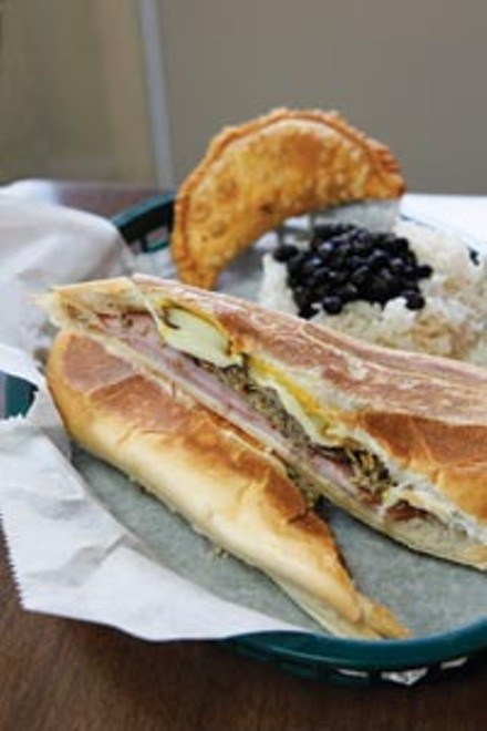 The Black Bean Cuban sandwich with rice, beans and beef empanada - HEATHER MULL