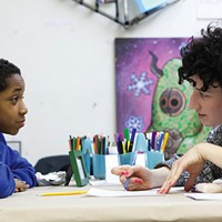 The LAB's Paula Levin does a timed writing exercise with Tyrek, age 11, where they exchange work and take turns critiquing and proofreading.