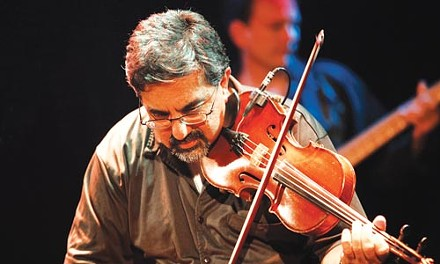 "The night's emcee, Bob Banerjee backs up many of the performers on fiddle, mandolin and guitar. ""Be kind and mindful, be creative, try to get out of your box if you're a singer-songwriter,"" he says. - HEATHER MULL"