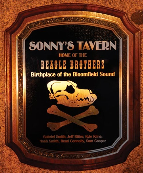 The plaque to be hung at Sonny's Tavern the night of the Beagle Brothers' listening party - PHOTO BY HEATHER MULL