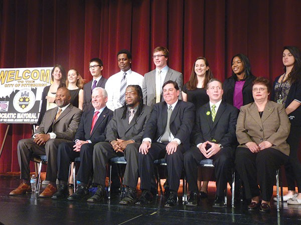 The six Democratic mayoral candidates posed for photos with student organizers after the March 17 debate at Pittsburgh Obama 6-12 School