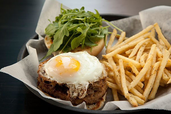 The Turducken Burger is a turkey burger with duck confit, sage aioli, fried egg and arugula.