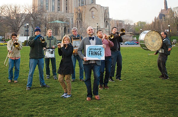 Theatrical outlier: Fringe Festival founder Dan Stiker poses earlier this month with musicians in Schenley Plaza.