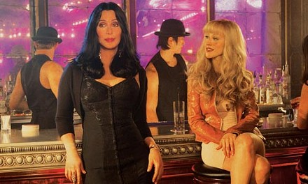 These dolls can sure sing! Cher (left) and Christina Aguilera