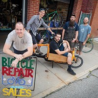 Thick Bikes owner Chris Beech (front) and crew hang out around a cargo bike.