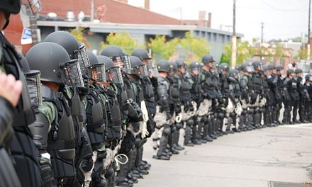 Thick blue line: Officers in full riot gear, before a Sept. 24, 2009 confrontation with protesters in Lawrenceville - CHARLIE DEITCH