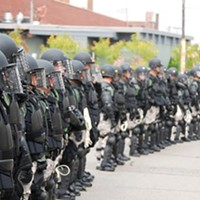 Thick blue line: Officers in full riot gear, before a Sept. 24, 2009 confrontation with protesters in Lawrenceville