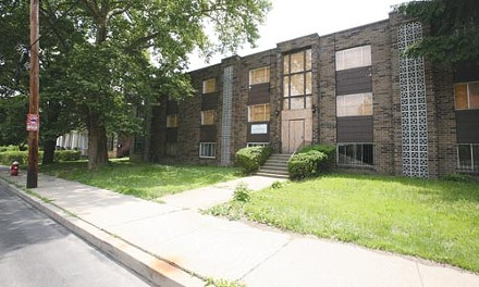 This apartment building at 5620 Rippey St., in East Liberty, was once owned by a convicted drug dealer. The federal government wants to turn it into housing units for ex-convicts. - PHOTO BY HEATHER MULL