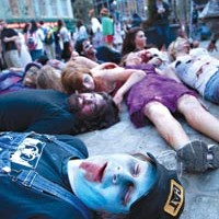 This city is dead: Greg Ochaba (center), of Butler, joins the fun at World Zombie Day, Oct. 10 at Market Square.