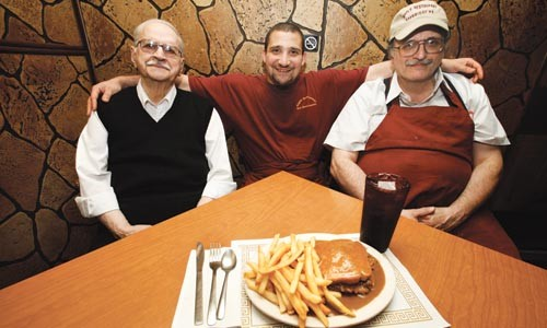 Three generations of the Pappas family (from left), James, Fred and Tom, serve up the Maple Restaurant's famous hot roast-beef sandwith. - HEATHER MULL