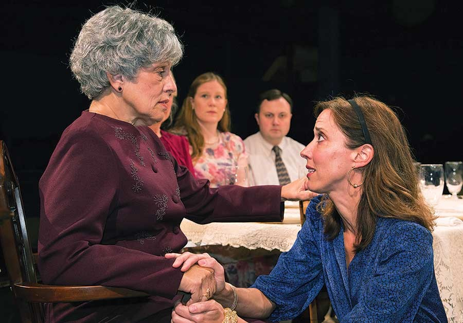 To heir is human: Janet Robb (left) and Mary Liz Meyer, in the foreground, in Little Lake Theatre's Dividing the Estate