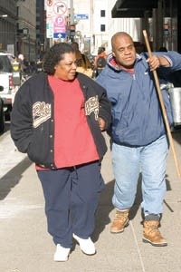 Tommie Lee helps Dorsey navigate a Downtown sidewalk.