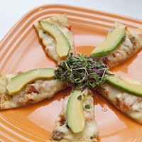 Wild Sage Tostado flat bread with tequila lime chicken queso blanco shallots and sliced avocado Photo by Heather Mull