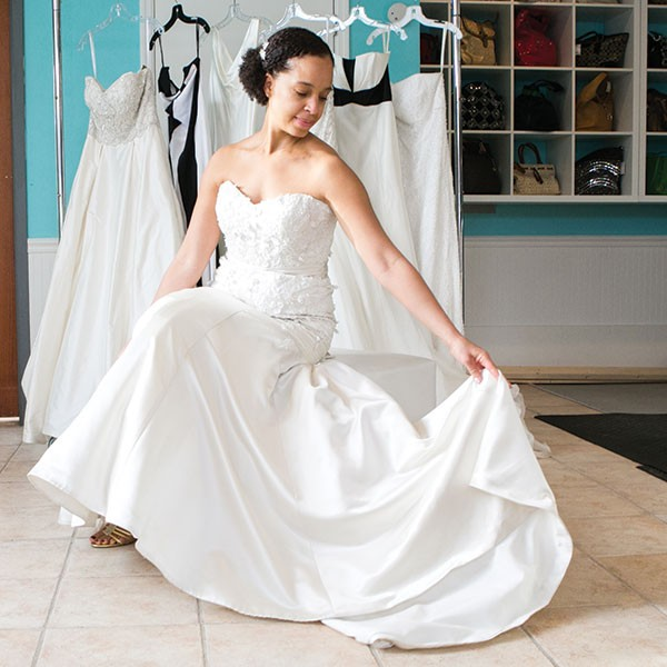 Tracy Mahood models a wedding dress available at Style Exchange Boutique