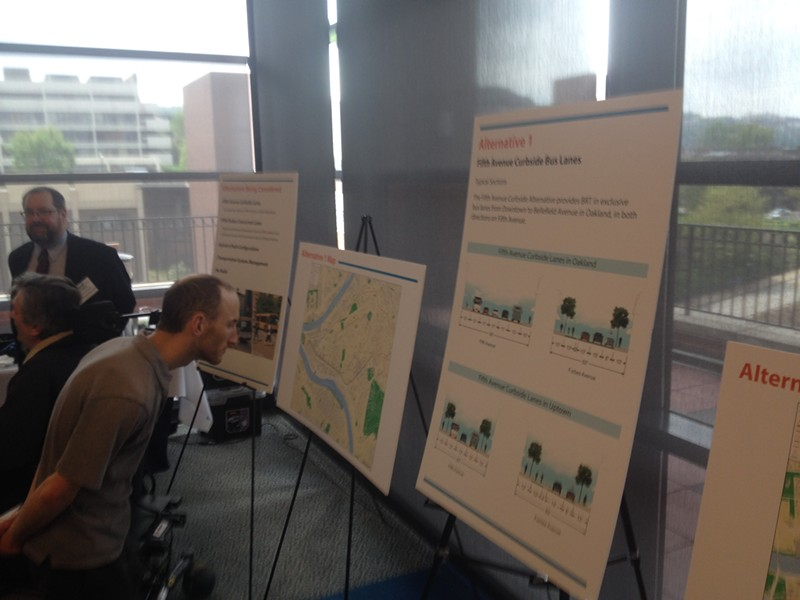 An audience member checks out one possible BRT schematic. - PHOTO BY ALEX ZIMMERMAN