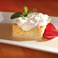 <i>Tres leches</i> (three-milk cake), with berries