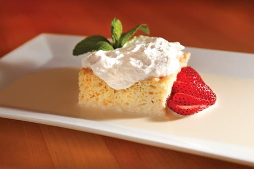 Tres leches (three-milk cake), with berries - PHOTO BY HEATHER MULL