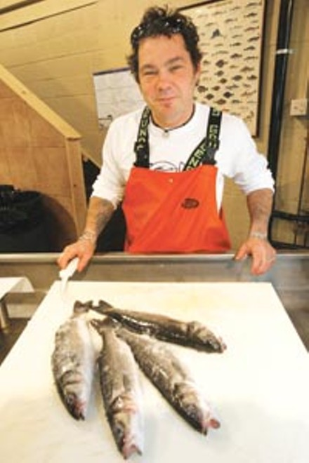 Tuesday's transformation: Penn Avenue Fish Company's Henry Dewey turns fish into tacos. - HEATHER MULL