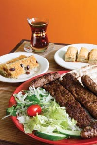 Turkish delights: acili adana with Turkish tea, and dessert dishes kadayif and baklava. - HEATHER MULL