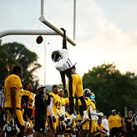 Justin Hunter dunks the ball over the goalpost after catching a touchdown pass.