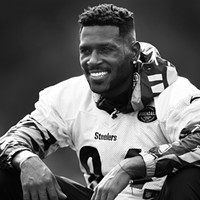 Antonio Brown watches practice.