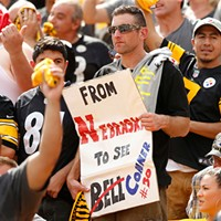 A Pittsburgh Steelers fan holds up a sign against the Kansas City Chiefs during the game at Heinz Field