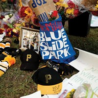 Mementos left at Mac Miller's memorial at Blue Slide Park