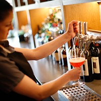 Bartender Paige Barker pours a drink.