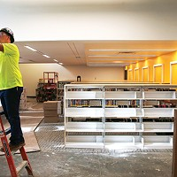 Construction takes place at the Carnegie Library in Carrick during a passive house tour on Thu., Oct. 11.