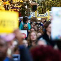Thousands march through streets in opposition to Donald Trump's Pittsburgh visit
