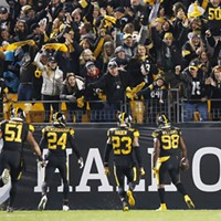 Vince Williams and the Steelers defense celebrate a pick six.