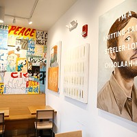 The interior of Choolaah BBQ, which features 25 different original works of art.