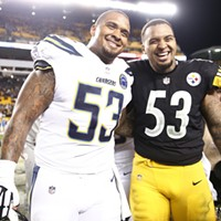 Twin brothers Mike (left) and Maurkice Pouncey (right) pose for a photo postgame.
