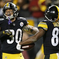 Antonio Brown celebrates his touchdown with James Conner