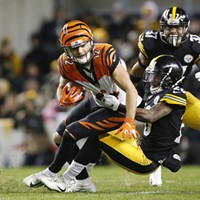 Mike Hilton #28 of the Steelers tackles Alex Erickson #12 of the Bengals.